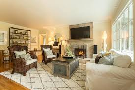 transitional living room with nuloom moderna moroccan ivory area rug hardwood floors pottery