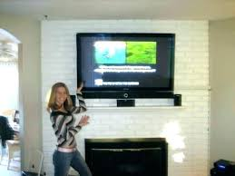 mount tv to brick fireplace how to mount over fireplace and hide wires
