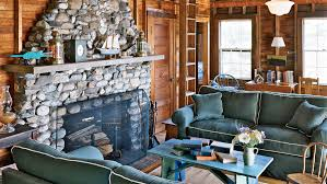 living room interior design with fireplace. Family Room With A Large Stone Fireplace, Wooden Walls And High, Exposed Beams Living Interior Design Fireplace