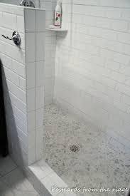 fabulous bathroom decoration with pebble tile shower floor design ideas interesting white bathroom design ideas