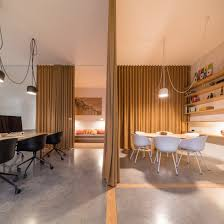 office space dividers. Pure Office Space By Sílvia Rocio, Mariana Póvoa And Esse Studio Was Designed To Have A Cozy, Flexible Atmosphere Where Curtains Separate The Different Dividers C