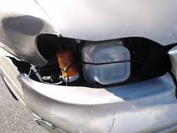 necessity is the mother of invention when it comes to car fixes    duct tape flat headlight fix