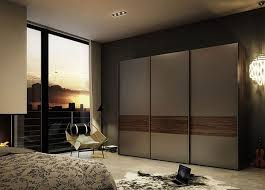Superb Agrreable Bedroom With Sliding Closet Doors Near Visible Glass Windows Also  Affordable Chair