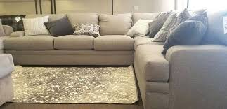 area rug with sectional in front of