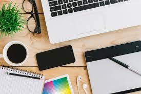 Graphic Designer At Desk The Importance Of A Professional Graphic Designer Blackcat