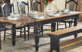 farm table with 5 inch turned legs black base and stained pine top in natural