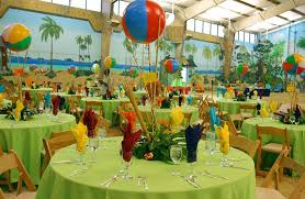 Cute beach party table decor with colorful ball centerpieces