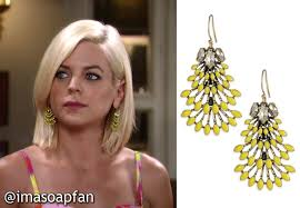 maxie was wearing yellow stone and clear crystal chandelier earrings by stella dot that perfectly matched her pink and yellow romper big thanks to an