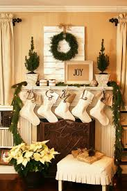 Joyful and bright Christmas living room fireplace mantel decoration in  natural green and cream color theme. Welcome Santa: Lovely Christmas  Decorating Ideas ...