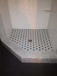 black and white hexagon tile floor. Small Bathroom Takes On A Classic White Hex Tile Floor With Strategic Hand Placed Black Accents And Hexagon W