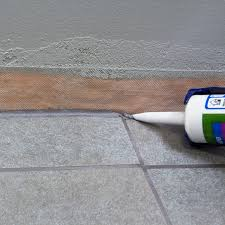 applying grout sealer to the joints