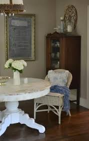 cote fix dining room table with white wicker chair and bright blue accessories find this pin and more on round kitchen tables