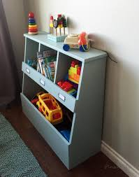 the top also serves as a smaller shelf for smaller toys books or even decor