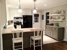 kitchen wall mounted shelving ceramic tile backsplash black metal bar stool glass front upper cabinets white
