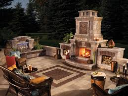 cool brick patio designs with wood arm chairs and outdoor fireplace for backyard ideas