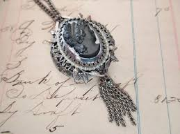 2 sided lucerne watch and cameo pendant