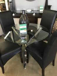 round glass table with chrome base and black leather chairs for in fountain valley