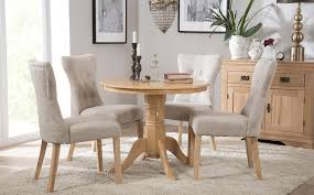 gallery kingston round oak dining table with 4 bewley oatmeal chairs