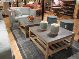 modish rectangle gray marble top stone coffee table with wooden base on gray rugs as decorate in modern open living room furnishing ideas
