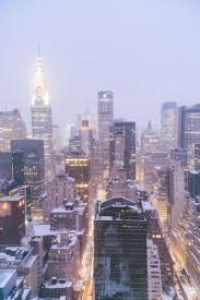 new york city skyline the chrysler building in the snow  new york city skyline the chrysler building in the snow catch a sunrise on a winter morning and watch the snow fall onto the skyscrapers of m