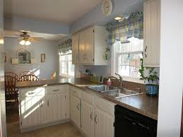 Raised Kitchen Floor Cottage Kitchen With Limestone Tile Floors L Shaped In Webster