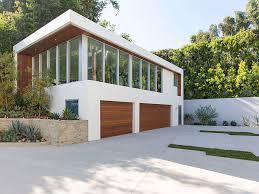 Modern Garage with Cedar Garage Doors