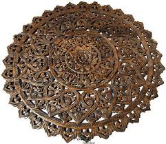 large round carved wood fl wall