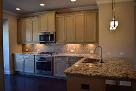 luxury tile backsplash with snowfall granite inspirations of snowfall granite countertops