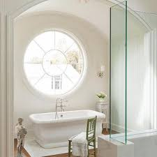 arched bathtub alcove with shiplap trim