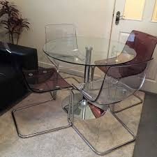 round glass top dining table with 4 ikea tobias chairs