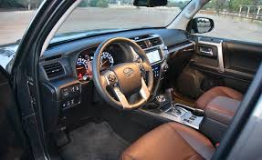 fake wood silver trim and redwood brown leather seats dressed up the 4runner limited s interior