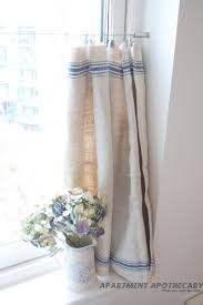vintage linen grain sack cafe style curtain like how they are hung no visually heavy bar in the way when they are pulled back my kitchen
