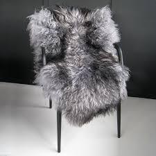amazing soft and fluffy long curly haired giant single icelandic sheepskin rug