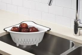 oxo s over the corner colander latches on to a sink corner for efficient and convenient s