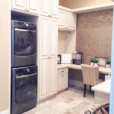 laundry room office. stackable washerdryer and party in laundry room love the desk addition office i