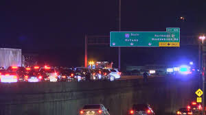 Woman killed on I-55 was grabbing phone that flew out window, police say