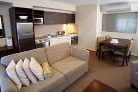 Amazing Design Of The Single Bedroom Apartments With Brown Fabric Sofa  Ideas Added With Brown Wooden