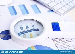Magnifying Glass Graph Paper And Keyboard Stock Image