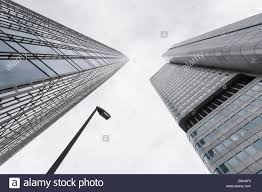 office facades. Germany, Hesse, Frankfurt, View To Facades Of Modern Office Buildings  Skyper And Silver Tower From Below