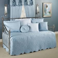 elegant blue daybed bedding with cozy berber carpet and elegant grommet curtains