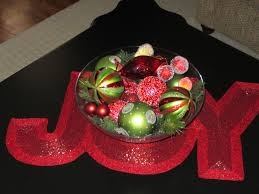centerpiece for coffee table with glass bowl filled green red ornaments on joy letter table
