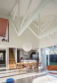 scott architectural lighting s3000. barn - the inverted trusses subtly establish distinct spaces in great room, with bottom edges lending an intimate feel to living area. scott architectural lighting s3000