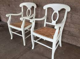 pair of white pottery barn napoleon rush seat chairs made in italy chairs retail for