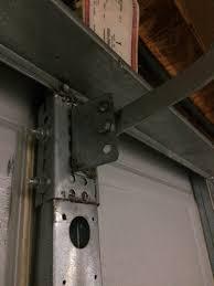 broken garage door opener arm bracket 1 jpg