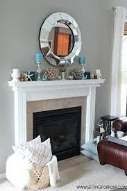 living room mantel decorating ideas see this living room fireplace mantel decor like the fireplace decorations lantern candle basket with pillows gray walls
