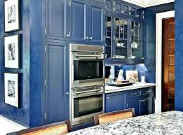 dark blue kitchen cabinets wood wall color
