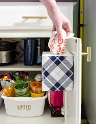 a cabinet door mounted tissue box is perfect for storing leftover plastic ping bags