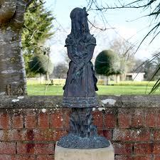 back of the alice sculpture wonderland garden ornament set