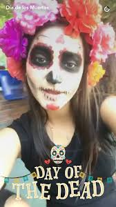 the snapchat story begins with a woman in skull face paint who says in mexico we celebrate instead of fearing it