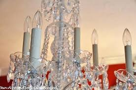 chandelier socket covers transform an ordinary chandelier with resin candle covers and silk with regard to
